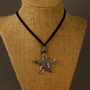 star pendant on leather